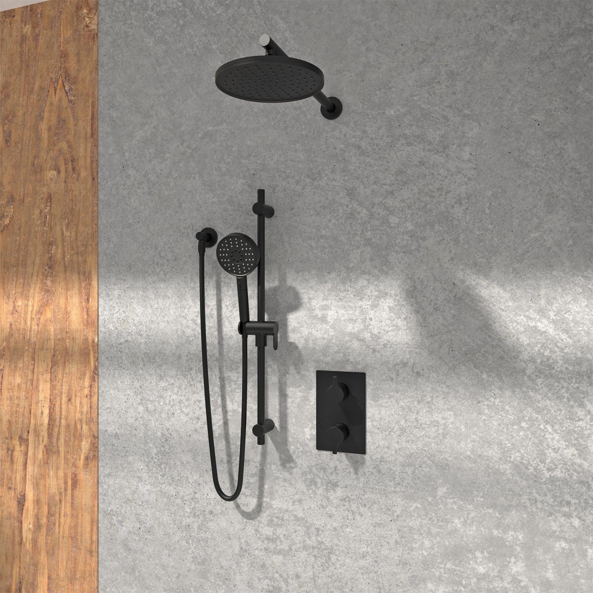Kit de douche noir mat dans une douche en pierre et un mur en bois
